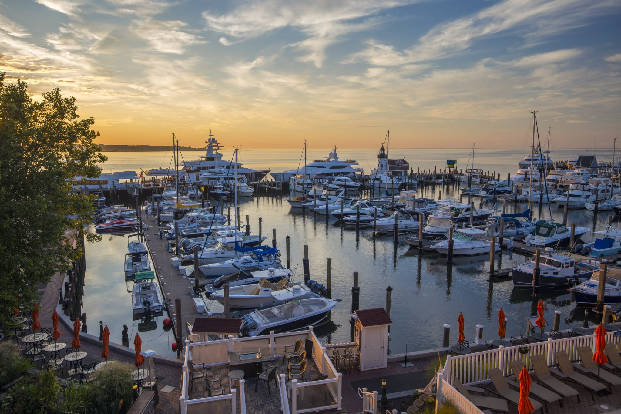 Sunrise over a marina full of boats