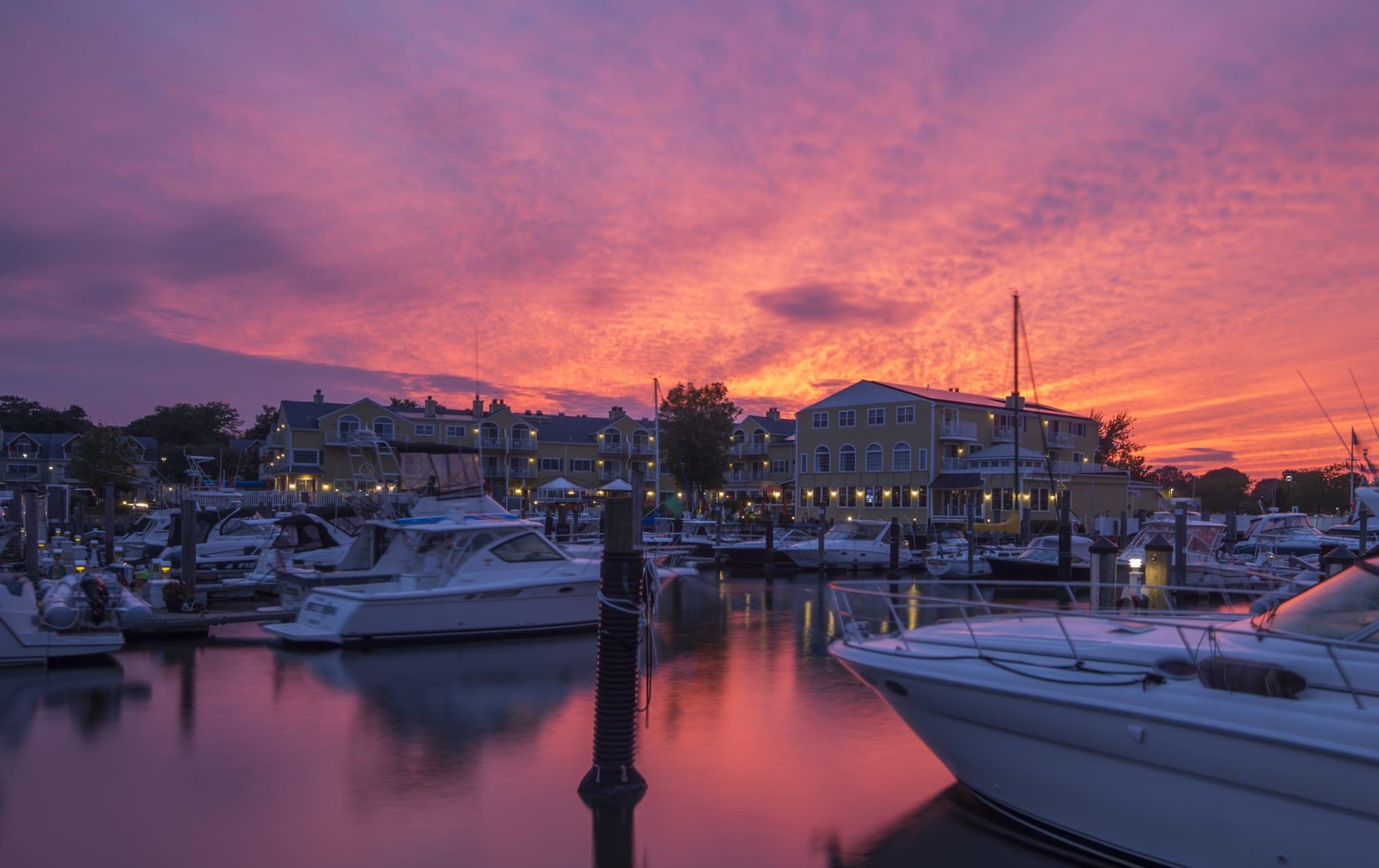 Boats in marina at sunset.