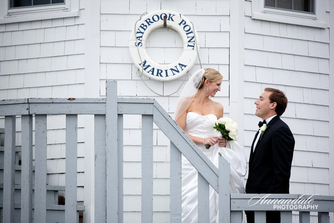 Bridal couple together at Connecticut lighthouse.