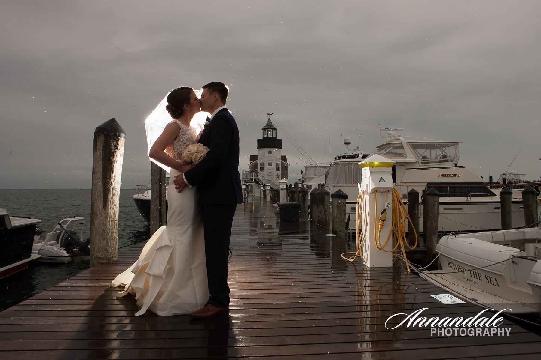 Bride and Groom kissing in front of the lighthouse.