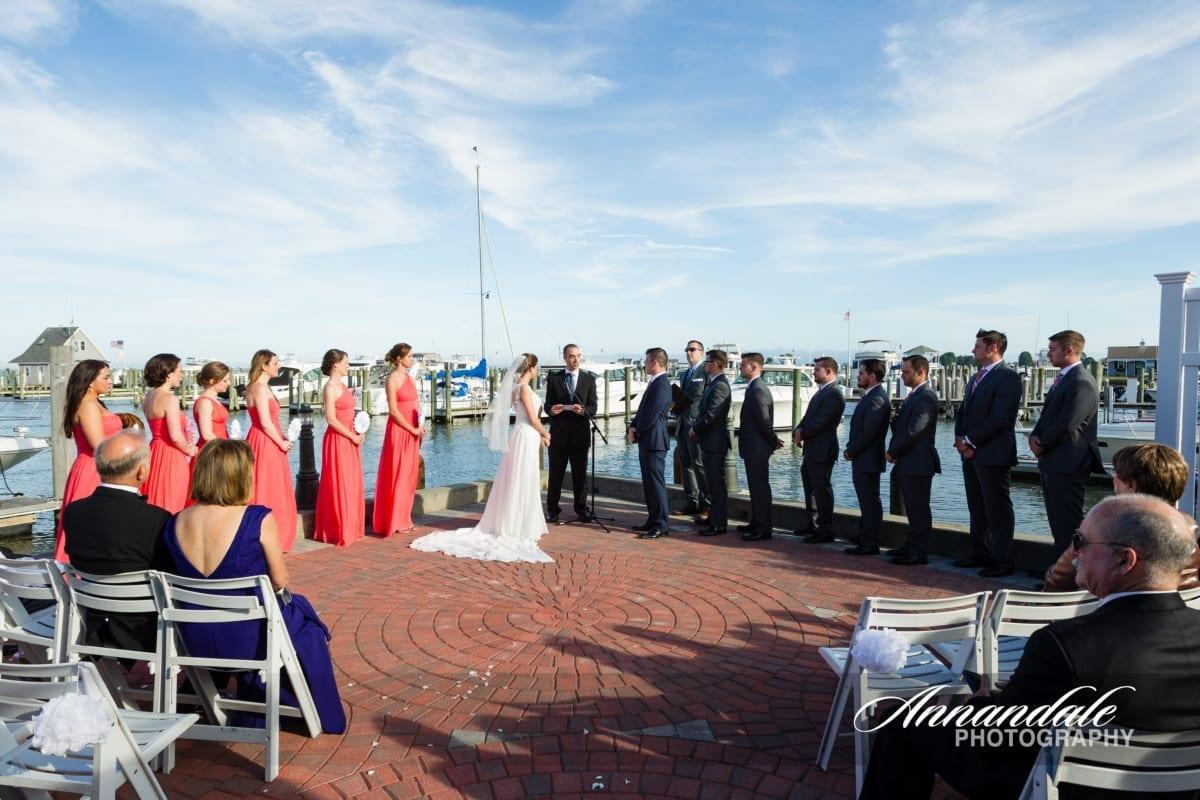 Outdoor wedding ceremony on hotel patio near marina.