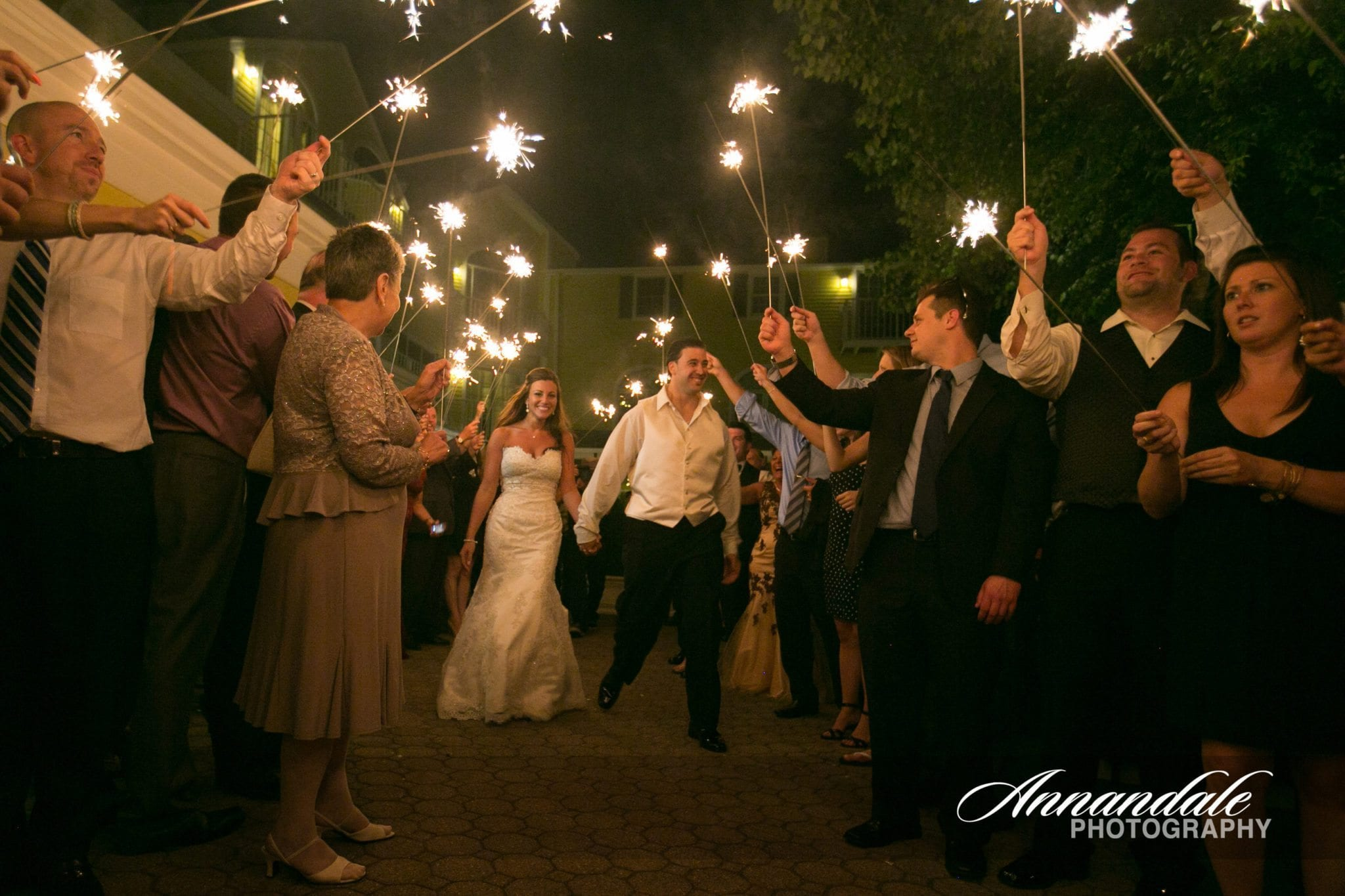 Wedding couple showered in sparklers.