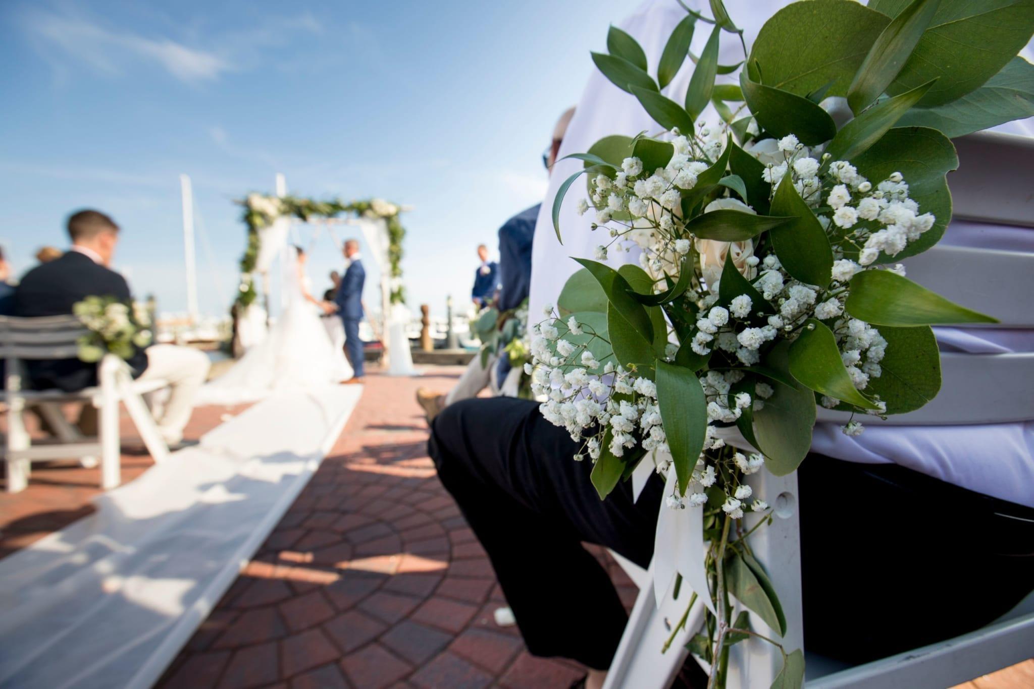 Wedding flowers on ceremony seating.