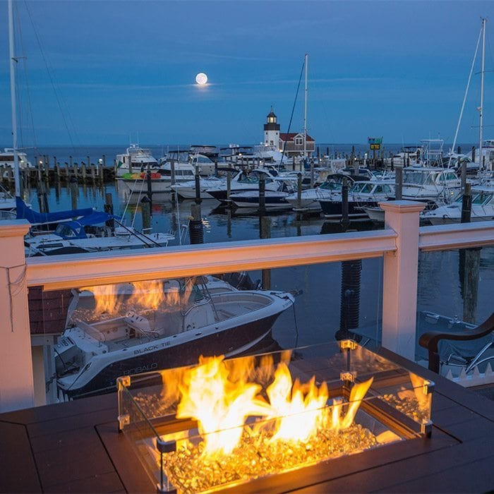 Fire Pit at the Marina Bar At Nighttime With Full Moon
