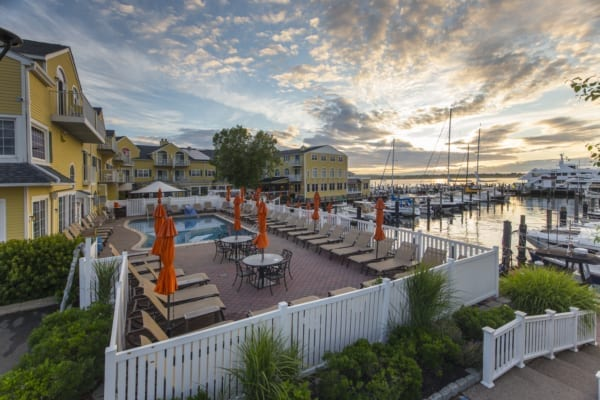 Outdoor hotel pool near marina.