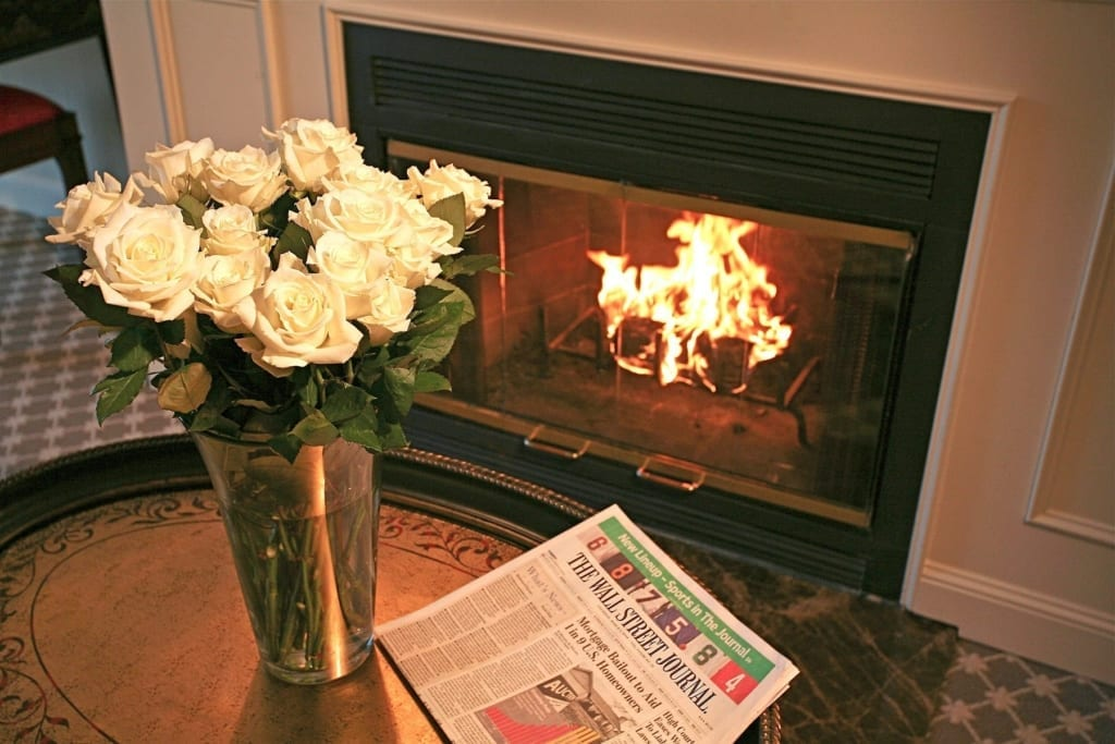 Flowers near fireplace.