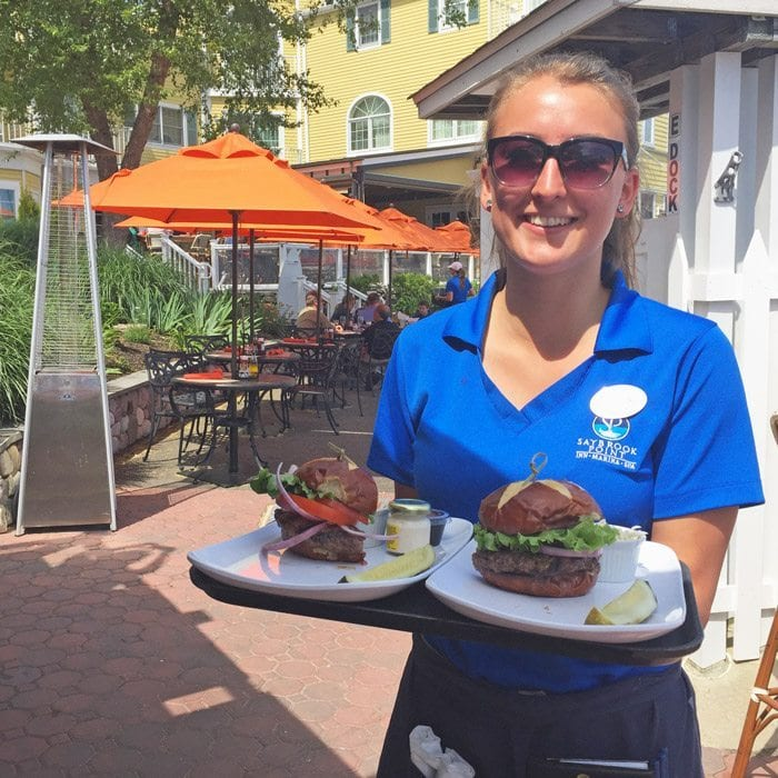 Server at the Marina Bar With Two Hamburgers From Fresh Salt Restaurant