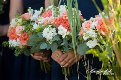 Bridesmaids holding flowers.
