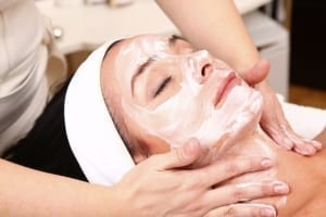 Woman getting spa face treatment.