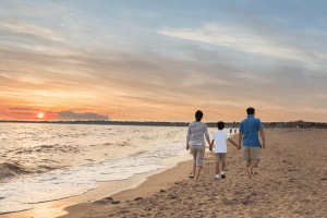 Photo of a Family Walking on the Beach in Old Saybrook CT.