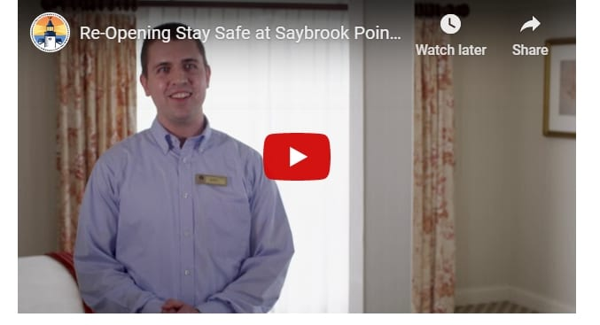 Video screenshot of employee. Text: Re-Opening Stay Safe at Sayborok Point.