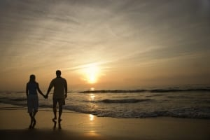 Photo of a Couple on an Atlantic Ocean Beach. Old Saybrook is One of the Most Romantic Getaways in New England.