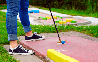 Photo of a Person Playing Mini-Golf near Old Saybrook, CT.