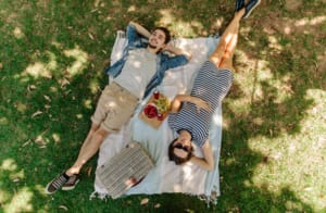 A couple enjoy a nice romantic picnic, one of the many things to do in Old Saybrook, CT while staying at Saybrook Point.