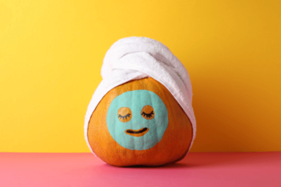 Pumpkin with facial mask and head-wrap towel.